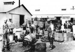 Orange County Sheriffs' deputies dumping illegal booze, Santa Ana 3/31/1932